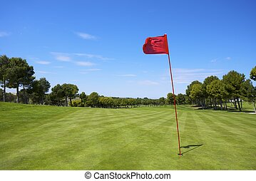 golf - view of a golf course with a red pennant