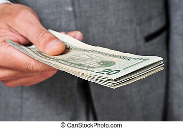 man in suit with a wad of dollars - a man wearing a suit...