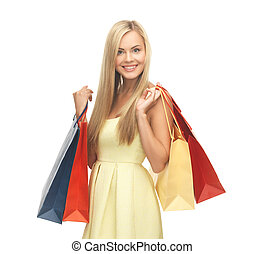 excited woman with shopping bags - picture of happy woman...
