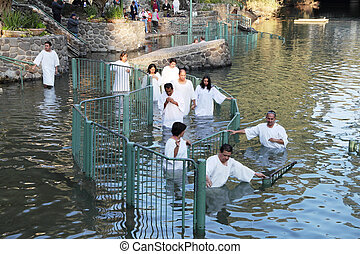 Pilgrims enter the water
