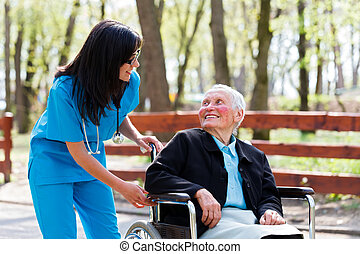 Kind Doctor Chatting With Elderly Lady - Beautiful doctor,...