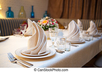 Table Setting - A very nicely decorated wedding table with...