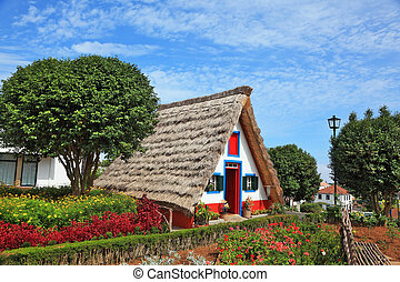 The cottage  and gable small garden with flowers