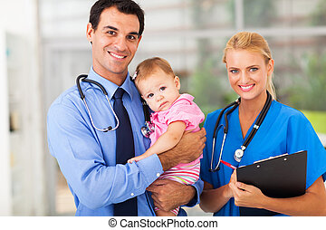 pediatric doctor and nurse with baby