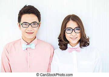 Happy Couples in living room with smart casual dress