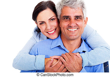 middle aged couple - loving middle aged couple on white...