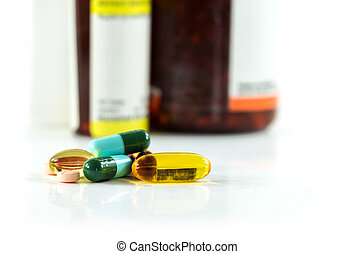 Closeup group of pills and bottle background