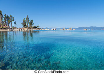 Lake Tahoe - Beautiful blue clear water on the shore of the...