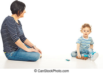 Mother playing home with her son