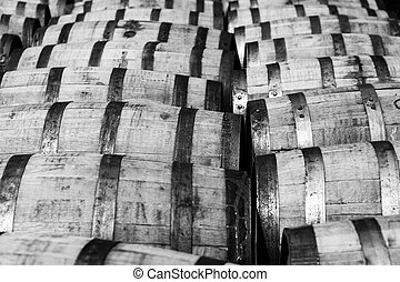 Bourbon barrels - Rows of oak bourbon barrels at a...