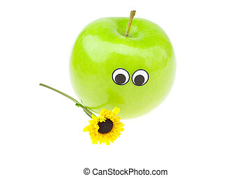apple with eyes and a flower isolated on white