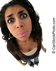 funny expression - A teenage girl with a funny expression....