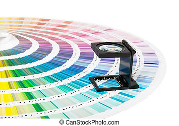 Magnifier and pantone guide - Magnifying glass standing on...