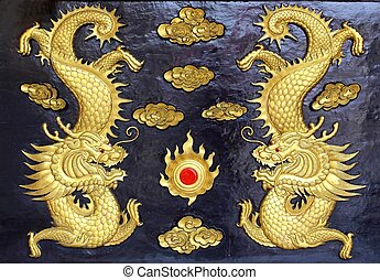 two golden dragons (Chinese: Long) wood carving in black...