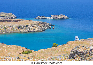 View from above of the main beach in Lindos, Rhodes, one of...
