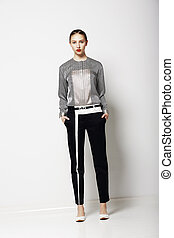 Attitude. Glamor. Fashion Model in Modern Grey Costume. Spring Time Collection. Trend