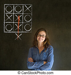 Thinking out of the box woman on blackboard background -...