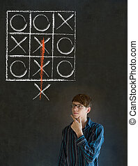 Thinking out of the box man on blackboard background -...