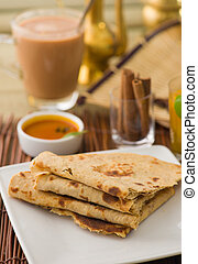 Chapati , Indian flat bread in plate usually served with...