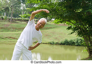 asian senior man workout in the park