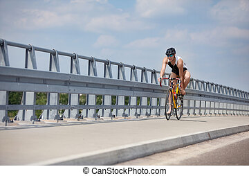 biker starting riding - triathlonist - biker starting riding...