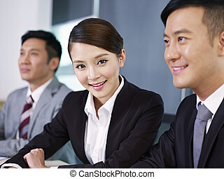 asian business people - young asian businesswoman in a...