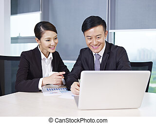 asian business people discussing business in office