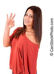 bonito, mulher, sorrindo, mostrando, ok, sinal