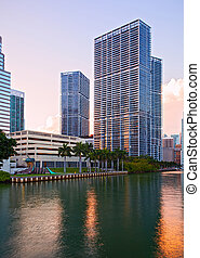 Miami Florida, Brickell and downtown financial buildings over miami River on a beautiful summer day before sunset