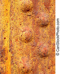 Rusted Rivetted Metal - Close up of rusted riveted sheets of...
