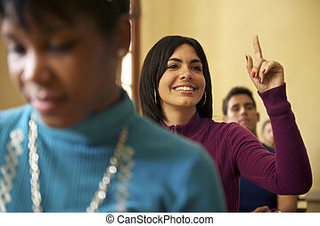 People at school, student raising hand and asking question to professor during class in college, Law School, University of Havana, Cuba