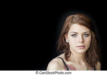 Young Woman with Beautiful Green Eyes - Portrait of a young...