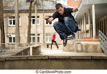 Parkour men - Men does a parkour jump