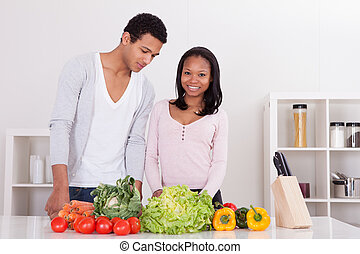 Couple Chopping Vegetables