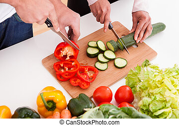 Couple Chopping Vegetables - Portrait Of Couple Chopping...