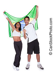 Young Couple Holding Brazil Flag - Couple Holding Brazil...