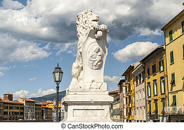 Pisa Tuscany - Statue of lion and colorful houses - Pisa...