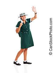 teen schoolgirl waving her hand