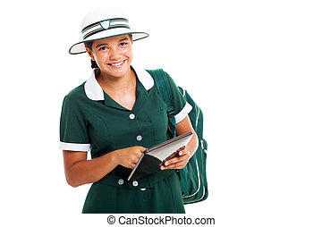 smiling teen schoolgirl with tablet computer