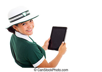 schoolgirl looking back holding tablet computer