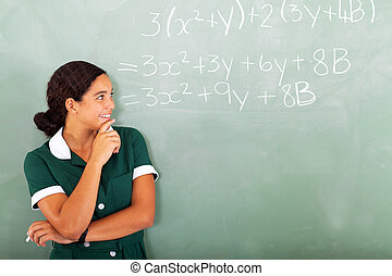 female high school student in classroom - happy female high...