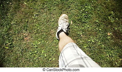 Man Walking on dirt and grass