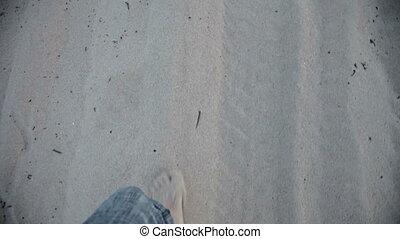 Man Walking in sand barefoot