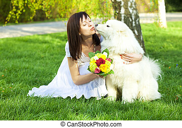 young bride and the dog on the nature
