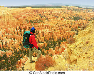 Backpacker resting at Inspiration Point, Bryce Canyon...