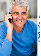 mature man talking on mobile phone - happy mature man...