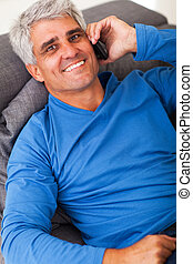 middle aged man talking on mobile phone - overhead portrait...
