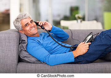 middle aged man talking on the telephone - cheerful middle...