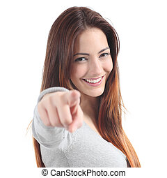 Close up of a beautiful teenager smiling and pointing at...