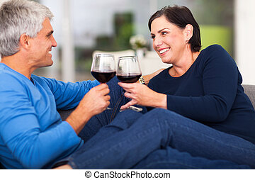 middle aged couple enjoying wine - cheerful middle aged...